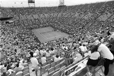 Our city's nod to tennis as big business came in a noisy, charmless mingling of steel and concrete. But we still loved the place.  A match at the 1994 United States Open between Pam Shriver and Lindsay Davenport. Credit Suzanne DeChillo/The New York Times