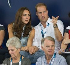The Duke and Duchess of Cambridge were also seen making a very public display of affection as they cheered on the Welsh swimmer during their visit to the Games 28 July 2014