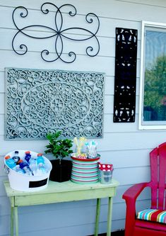 Outdoor Wall Art {DIY}. Use door mats for shutter-like decorative frames for windows or doors