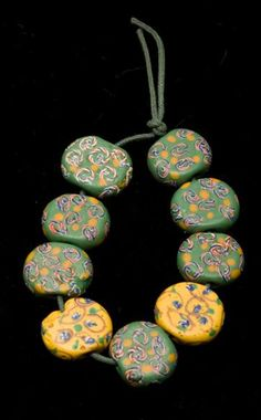 Partial strand of polychrome-decorated beads with circular and dotted designs | 19th - 20th century || Europe (Venetian) ~ African Trade Beads