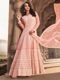 Amusing pink embroidered gown anarkali for women available at Inddus. This elegant set comprises a viscose georgette anarkali kurta with cotton leggins also paired with net dupatta. Anarkali Tops, Anarkali Lehenga, Latest Anarkali Suits, Salwar Suits, Designer Anarkali, Gown Suit, Salwar Kameez, Churidar, How To Dye Fabric