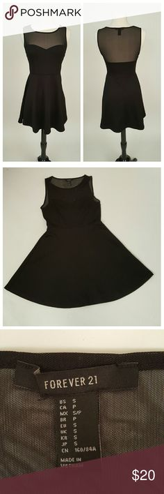 Forever 21 Black Skater Dress Forever 21 black Skater Dress with illusion neckline. (I am on vacation, items purchased now can be shipped September 12) Forever 21 Dresses Midi