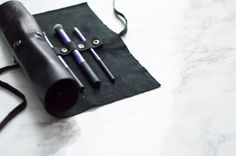DIY Leather Makeup Brush Roll :http://www.classicingray.com/diy-leather-makeup-brush-roll/