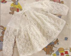 This is for a PDF pattern not the actual garments in the photograph. Two gorgeous patterns for baby girls angel tops/dresses    To fit size 16-20  Pattern for knitting in double knitting wool  Needle sizes: 3.25mm and 3.75mm (UK11 and UK9)    US YARN EQUIVALENT  Please check the tension/gauge provided in the listing against yarn label:    2ply/3ply = Super fine sock, baby, fingering  4ply = Fine sports weight yarn  Double Knitting/Quick Knit = Light DK/Light Worsted weight / 8ply  ARAN…