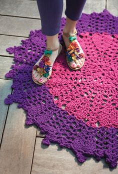 Peony Mat  Go for color in a cozy rug that makes any floor blossom—especially in kids' rooms!  By Margie Dougherty    YARN  RED HEART Super Saver Chunky, 6oz/170g skeins, each approx. 207yd/189m (acrylic)        1 skein #905 Magenta      2 skeins #776 Dark Orchid    CROCHET HOOK        Size N/13 (9mm) crochet hook