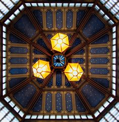 Artful ceiling - The beautiful central ceiling and lights at Leadenhall market in London.