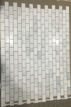 """Carrara Venato marble mosaic tile in 1 x 2"""" mini brick pattern. Polished finish. White marble mini subway tile backsplash. White marble with veins formed in wide waves. Tile Size: 12 x 12 in., 3/8"""" thick Uses: white marble brick backsplash tile, mini brick kitchen tile, mini brick bathroom tile"""