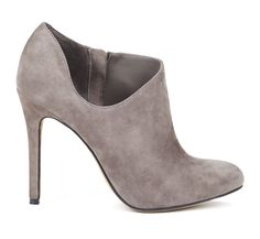 Almond toe d'orsay ankle bootie in genuine materials with side zip closure.