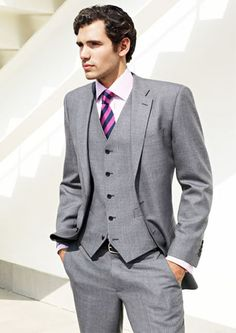 Grey suit with Chesire cat tie. Grey Suit Pink Tie, Suit And Tie, Gray Suits, Grey Tux, Gray Vest, Mens Attire, Mens Suits, Groom Attire, Modern Tailor