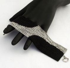 Square Stitch Beaded Bracelet Swerve Silver on Matte Black Bead Loom Bracelets, Beaded Bracelet Patterns, Fabric Jewelry, Jewelry Art, Matte Black Background, Beaded Jewelry Designs, Brick Stitch, Loom Beading, Bead Earrings