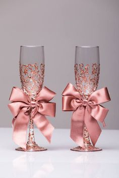 Personalized wedding flutes wedding champagne glasses champagne flutes toasting flutes rose gold champagne flutes wedding flutes Set of2 For these glasses color: rose gold All completely handmade! MEASUREMENTS: -Champagne flutes : Height - 9.2 inch (23.5 sm). Volume – 170ml (6.1 oz) Custom champagne glasses may be created to fit your needs. Your unique wedding colors can be used for this design. Names and date may be painted to customize to your occasion. Glasses will be carefully packed