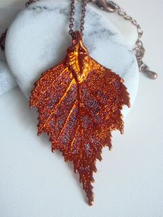 Handmade Real Birch Leaf - all our maple leaves are one-of-a-kind, beautiful real leaves, dipped in precious metals. After being boiled in a base solution, each leaf is skeletonized with a brush or sand blaster, then dipped in copper, then in 24K Gold, Sterling Silver or Iridescent Copper. Preserved forever through the process known as Electroforming. Amazing and unique, handmade in Los Angeles one by one.