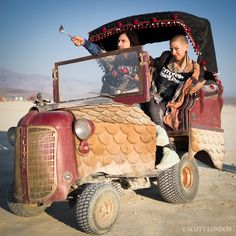 This hobbled vehicle, part of Mr. Toad's Gypsy Wagon, was stranded out on the playa without a rear wheel. It turned into another interactive art piece, with people doing spontaneous performance art and outlandish photo shoots. (Photo by Scott London)