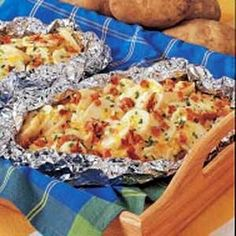 Divide the potatoes and onions equally between two pieces of heavy-duty foil (about 18-in.