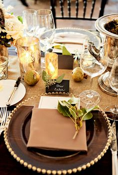 Fall-Inspired Wedding Table: Dark Wooden Reception Table with Gold Accents | Brides.com