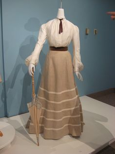 White damask blouse (c. 1900), linen skirt (c. 1900), cream silk parasol (c. 1925), straw boater (c. 1930)