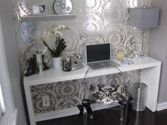 I love the idea of using metallic wallpaper (or some other graphic wallpaper) in a nook to accentuate it