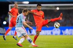 Rafinha of FC Barcelona challenges Michael Krohn-Dehli of Celta Vigo during the La Liga match between Celta Vigo and FC Barcelona at Estadio Balaidos on April 5, 2015 in Vigo, Spain.