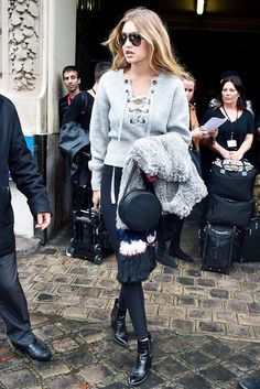 Model off-duty: Gigi Hadid pairs her lace-up sweater with leggings and boots