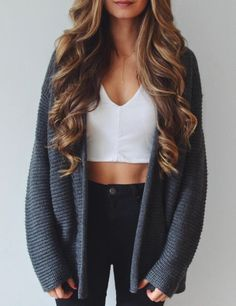 white crop top with a gray cardigan sweater