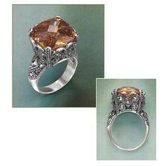Empress Topaz CZ Ring  at pyramidcollection.com  Old World. Empresses and Czarinas might envy its opulence: this spectacular, checker-faceted topaz CZ, aglow in an elaborate setting of sterling silver, rich with accents of marcasite. Whole sizes 6-10.    ****  Empress Topaz CZ Ring  Item #: P41224  $59.95
