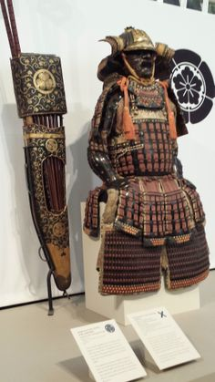 Suji bachi kabuto, mogami dou gusoku, on the left is a yumi -dai (archery set) consisting of a quiver, arrows, bows and a carrier. Samurai Exhibit, Portland Art Museum.