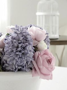 Purple flowers and Pink roses.