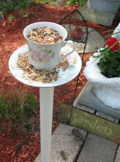 Tea cup bird feeders my mom made. We usually put water in the cup, though.