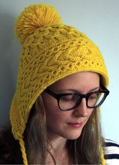 Free Knitting Pattern for Cabled Ski Bonnet - Lacey Volk's Neon Ski Bonnet features and cabled band and smocked crown