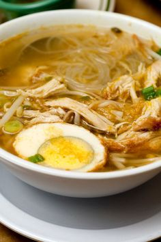 NYT Cooking: Soto ayam, an Indonesian version of chicken soup, is a clear herbal broth brightened by fresh turmeric and herbs, with skinny rice noodles buried in the bowl. It is served with a boiled egg, fried shallots, celery leaves and herbs, and is hearty enough for a meal.