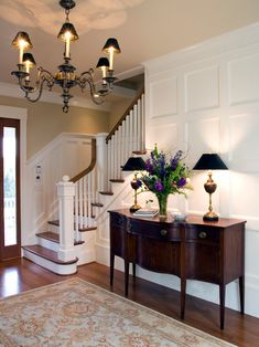 Elegant entryway. Buffet lamp and chandelier. Interior design ideas. More Decor Ideas http://www.bocadolobo.com/en/products/#cat-cabinets-bookcases