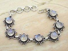 17.50ctw Genuine Rainbow Moonstone & .925 Sterling Silver Plated Brass Bracelet (SJHB0010RMS) #silverbracelets #braceletsilver #braceletdesigns #sterlingsilverbracelets #silverbraceletsforwomen #braceletsformen #sterlingsilvercharmbracelet #bracelet #personalizedbracelets #gemstonebracelets #handmadebracelets #silvercharmbracelet Buy Now: http://www.sterlingsilverjewelry.tv/genuine-rainbow-moonstone-silver-plated-brass-link-bracelet-sjhb0010rms.html