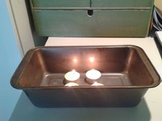 Making my own tea light heater: Step one - put tea lights in bread tin