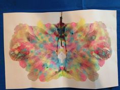 Toddler eye dropper butterfly paintings! Squeeze, squirt, fold, rub, open!