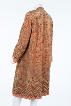 An art-deco embroidered orange velvet evening coat, circa 1928, embroidered overall in peach silks and metal threads with Delaunay-esque geometric patterns, lined in buff velvet. Sideway