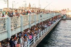 Fishermen and tourists are on the Galata Bridge on may 26 2013 in Istanbul Turkey The Galata Bridge  Stock Photo