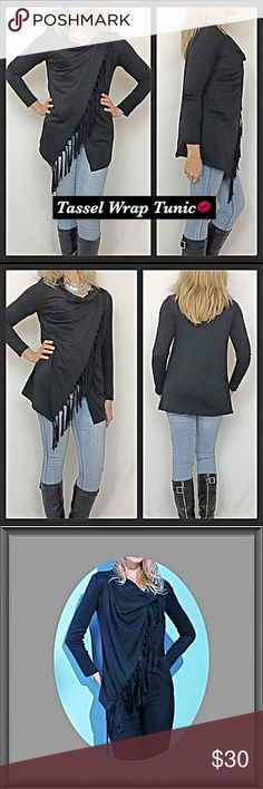 """Tassel Wrap Cowl Neck Tunic S M Gorgeous on trend sexy & sassy asymmetrical tassel wrap tunic in all black. Button closure on shoulder to hole wrap in place. Cowl neck & Tassel detail is a super cute. Pair with leggings or your favorite jeggings/skinnies. Poly cotton blend with some stretch.   Small Bust 34-36 Front Length 27.5"""" Back 24  Medium Bust 36-38 Front Length 28"""" Back 24.5 Tops Tunics"""