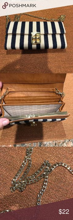 Cute clutch/wallet/crossbody🌸 Navy and natural striping on this adorable purse that can be used as a wallet, crossbody or clutch.  Plenty of room for cash,  6 credit cards, change and iPhone 7. Excellent condition. Bags