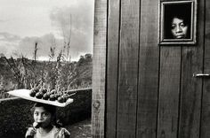 Guatemala [little girl carrying candy apples] 1978 gelatin silver print