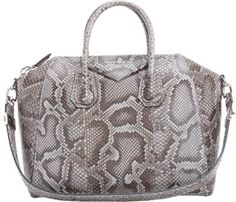 """Givenchy Pearl Grey python medium Antigona duffel.Metal logo lettering at top line; polished palladium-tone hardwareLined with nappa leather; one zip pocket and two organizational pockets at interiorRolled python top handles; flat python shoulder strapTop zip closure11.5"""" height x 13.0"""" width x 7.5"""" depth (approximately)3.5"""" handle drop, 10.5"""" strap drop (approximately)Made in ItalyItem cannot be shipped to California."""