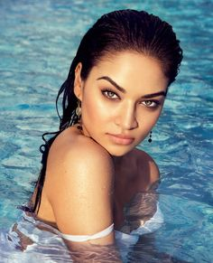 Shanina stuns with her hair slicked back and wearing a white La Perla swimsuit