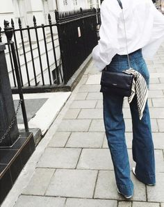 white shirt, mini black bag with tied scarf and high-waisted wide leg jeans #style #fashion