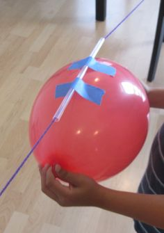 Make balloon rockets with kids - awesome boredom buster.