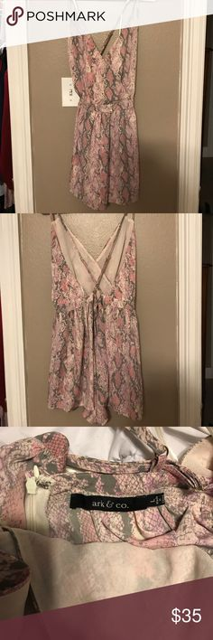 Pink strappy romper Snake skin pattern, strappy romper. Mostly open back but does have a zipper. Lower half is very flowing. Worn a handful of times. Super cute on. Size large. Ark & Co Dresses