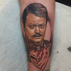 Bacon is the way to Ron Swanson's heart. Tattoo by Brendan Boz. #inked #inkedmag #tattoo #bacon #ron #swanson #heart #ink #art