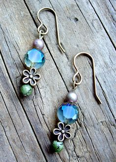 see om inspirations jewelry on FB. earrings, approximately 1 1/2 inches long, czech glass beads, faceted glass beads, antique brass ear wires, brass flower beads, $15 includes shipping within the U.S. buy the set (necklace & earrings) for $38. Feel free to send questions to me via facebook email. To order, send payment via paypal: yoginidb@yogafromthegroundup.com