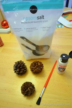 "How to give pine cones that ""snowy look"". Paint the tips white then sprinkle Epsom salts on the paint, let dry. Gives them the look of being frosted with snow."