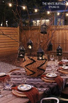 LANTERNS HANGING IN BRANCHES AS CENTERPIECE