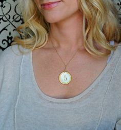 Wear this all the time! Miranda Frye mother of pearl poker chip necklace.  Circa 1920's.    www.mirandafrye.com