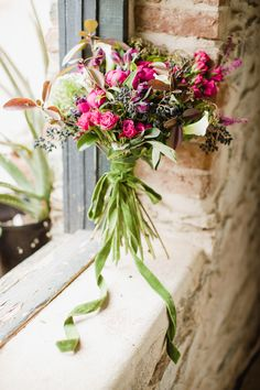 bouquet tied with a green velvet ribbon, photo by Love by Serena, styling by Sarah Park Events http://ruffledblog.com/oatlands-plantation-wedding-inspiration #bouquets #flowers